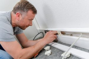 A. Wright electrical fixing a wall socket